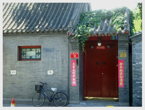 A Bike and Old  Style House at Beijing Huguosi Street.