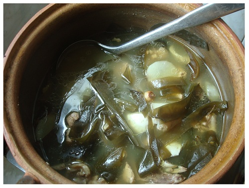 Chinese Chicken Kelp Herb Soup Cooked in Chinese Clay Pot.