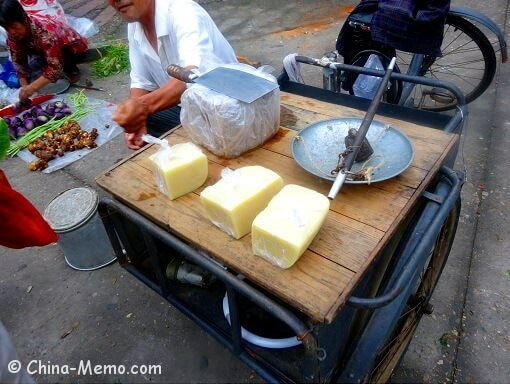 Chinese local selling rice tofu on a bike