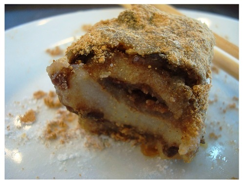 Old Beijing Snack Rolling Donkey, (Pastry made by steamed glutinous soy bean flour.)