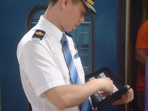 A Sleeper Train Staff Exchanges Your Ticket Before Boarding.