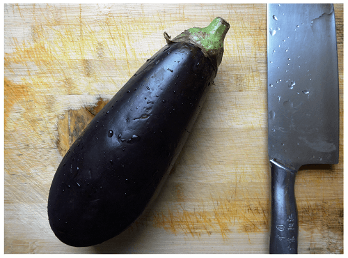 Eggplant and Chinese Kitchen Knife.