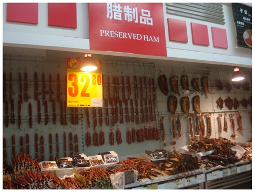 China Hunan preserved meat in local food market.