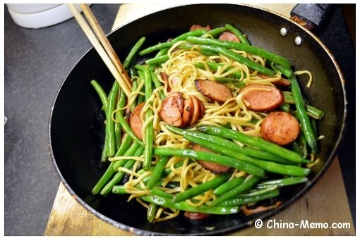 Chinese Noodle Fried with Beans and Smoked Sausages.