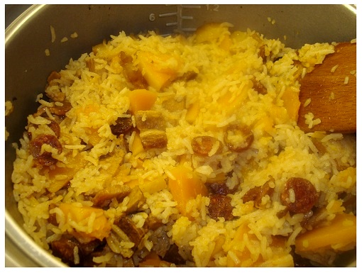 Chinese Squash Sausage Belly Rice Cooked in Rice Cooker.