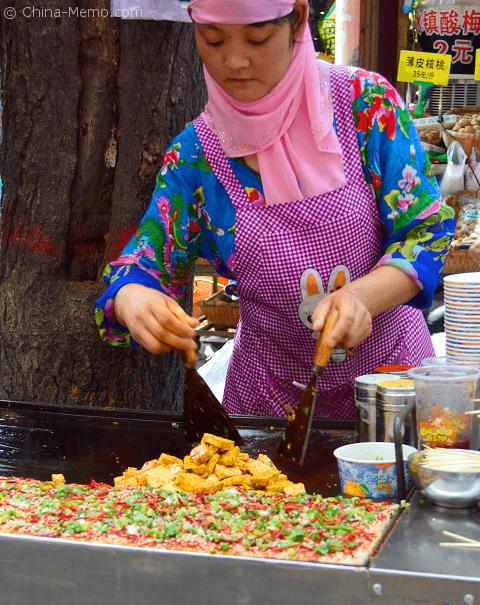 Xian Muslim Street Food. Making the fried tofu.