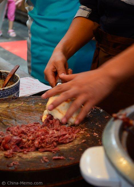 Xian Muslim Street Marinated Meat filled Bun.